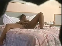 Mature woman masturbating at home
