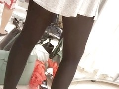 Sexy girl in mini skirt and black pantyhose upskirt