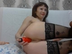 Amateur girl in stockings plays with her tasty opening
