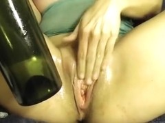 Amateur inserts wine bottle and whisk