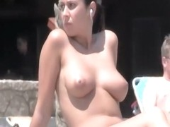 Topless girl listens to music