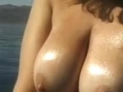 Cute youthful brunette hair disrobes by the water and goes slim dipping