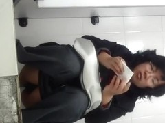 Chinese milf spied taking a piss