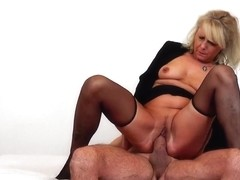 Blonde, Czech granny in erotic, black stockings is having amazing sex with a much younger guy