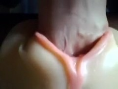 A plastic slit toy getting used closeup and jizzed