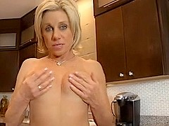 milf plays with her wet pussy D10