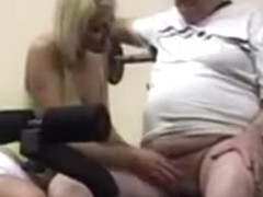 Young blonde sucks cock in the gym for this lucky old guy