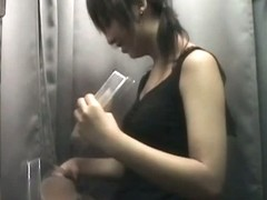 Two asian teens lingerie in a changing room