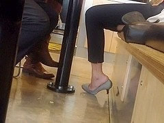 Shoeplay in a restaurant