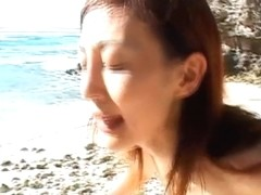 Mako Katase Asian doll is getting a gangbang on the beach