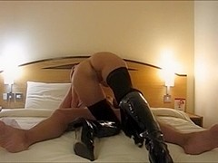 MILF with boots fucks in the hotel room