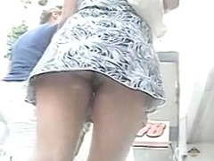 Street upskirt candid of leggy girls smooth ass