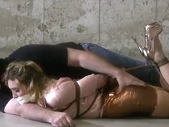 Woman with shiny clothes bound and gagged