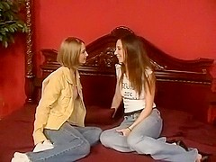 Slender girl lesbians lick, and caress one another.