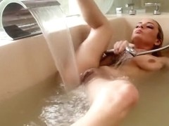 Ashlee Graham fucks herself in a glitter filled tub