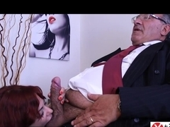 Italian, red haired babe is eagerly sucking cock in her office, before getting fucked hard