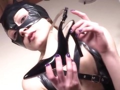 Two barefoot redhead CatWoman shows off feet and dominate