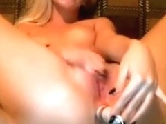 A vibrator is slipped by mILF on cam up her asshole