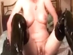 Mature In Latex Boots Finger Fucks Her Cunt In Bed