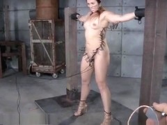 Brunette Struggles in Unique Bondage Device