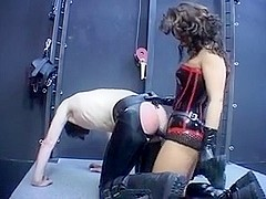 Mistress fucks her slave with a dildo
