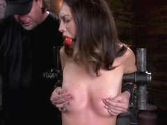 Brunette in metal stock pussy tormented