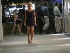A classy chick flashes her body in public.