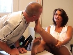 Mature boss giving him her feet to suck