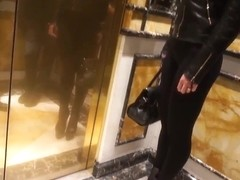 Julie Skyhigh in hot sexy legging hotel hall walking heels