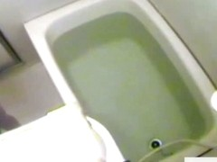 Slim Asian caught on bath hidden camera farting in the tub