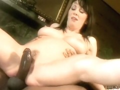 Busty brunette with great curves takes a ride on a big black cock