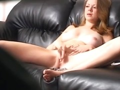 Lesbian chick on couch masturbating