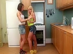Two lesbian cuties fuck with sex toys