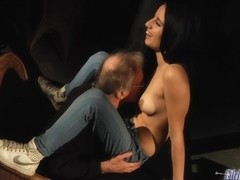 Kinky old man has hired a sexy brunette to suck his cock and let him fuck her