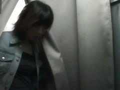 An asian cutie gets onto the changing room unaware of the hidden camera