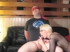 Blindfolded lucky guy sits on couch while his babe wife sucks and rides his cock