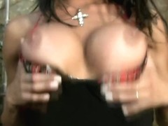 Attractive Latina tranny strips and licks her juicy breasts