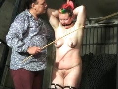 Tit whipping and hard caning of redhead amateur bdsm slave Bunny in rigid