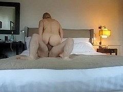 A couple fucking in a hotel room