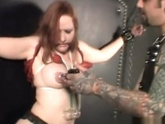 Busty redhead slave is tied up and punished by her tattooed master